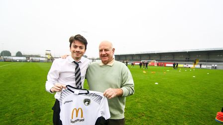 Alex Crowther with a Weston football shirt the club has donated to Ron Febrey. Picture: Will.T.Photo