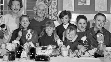 Mrs D. Edwards and Mrs M. Stevens are helped by children in the display of toys made by the Fellowsh