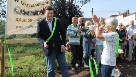 Wells MP James Heappey cuts the ribbon to open the piece of footpath in 2015.