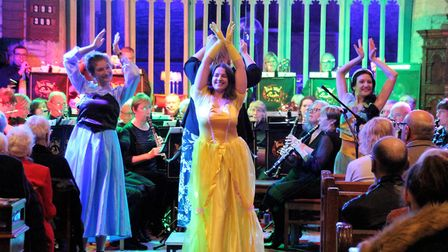 Trumpeter Lucy Findlay, flautist Becky Townsend and clarinettist Hayley Richards dancing to a Disney