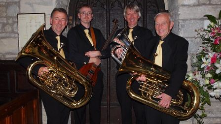 Members of the WorleWind Band, with oldest member Ken Heeney on right,