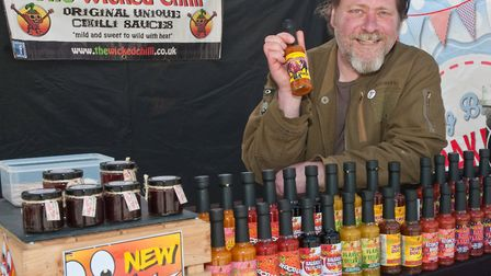 Lee Langridge with a new sauce for the festival called Chimera Dragon, from The Wicked Chilli. Pi