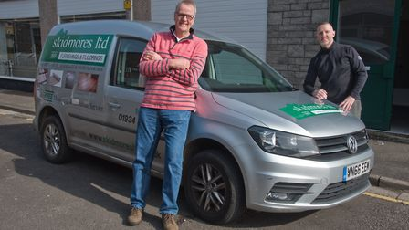 Brian and Mike Skidmore with one of their vans they will be using to deliver to the elderly. Pict