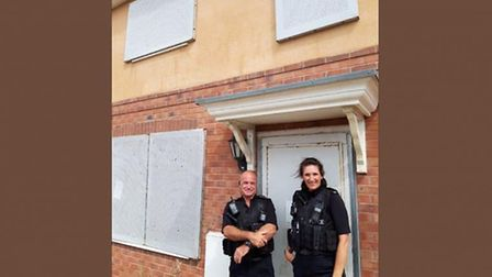 Anti-Social Behaviour Co-ordinator Cerwyn Pritchard and another officer at the property in in Wall C