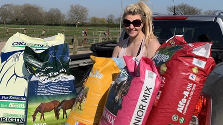 Bex Letts loading up thetruck with animal feed to be delivered.