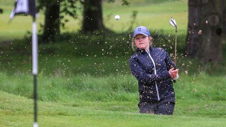 Katie Rule plays out of a bunker (pic Adrian Milledge)