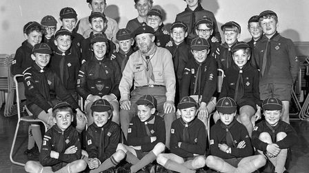 The District Scout Commissioner, Mr. F.H. Haynes pictured with cub scouts and leaders of the 2nd Uph