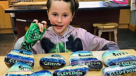 Lottie painting pebbles to raise funds for the NHS.