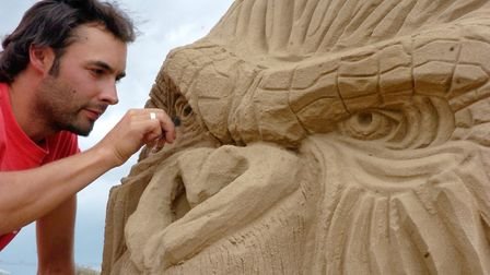 Sculptor Joris Kivits working on the giant gorilla the year the festival started. Picture: DAVID KEN