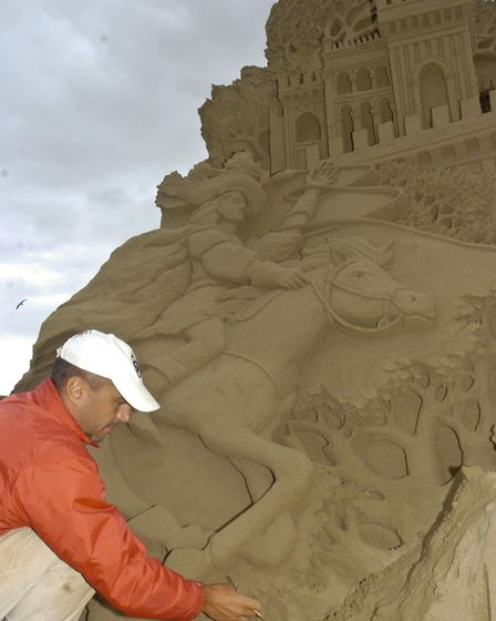 Sculptors Leonardo Ugolini from Italy working on their creations in 2007. Picture: DAVID KENNEFORD