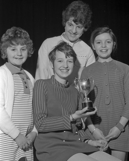 Pamela Rudge won the Junior Arts Cup (singing) for girls of 10-13 years. Julie King (left) and Anne