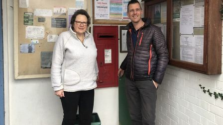Caroline Chennells and John Mathews standing beside Brent Knoll Village Shop.