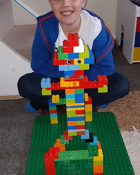 Cody with his Duplo model.