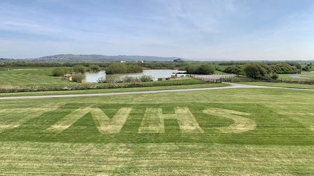 Staff at Warren Farm Holiday Park created this huge tribute to NHS staff. Picture: Warren Farm