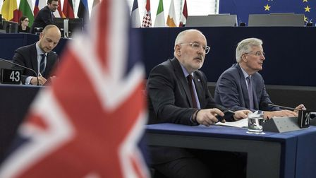European Union's Frans Timmermans, first vice president of the Commission, center left, and European