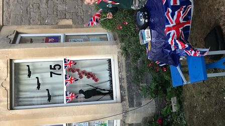 Nine-year-old Lewis Wilkinson decorated his home to maek the monenteous occasion. Picture: Carrie Wi