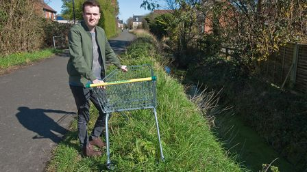 Cllr Ciaran Cronnelly with Morrisons' trolleys that have been dumped in the Weston Village area.