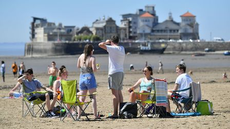 Sunbathers spent the day on the beach. Picture: Ben Birchall/PA Wire