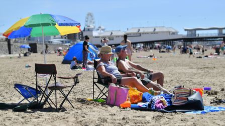 Sunbathers enjoy the hot weather in Weston. Picture: Ben Birchall/PA Wire