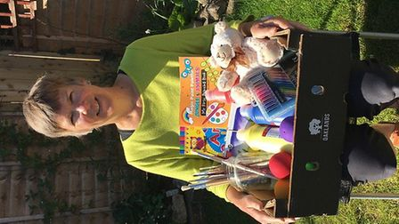 Susannah Crook with a selection of items donated.