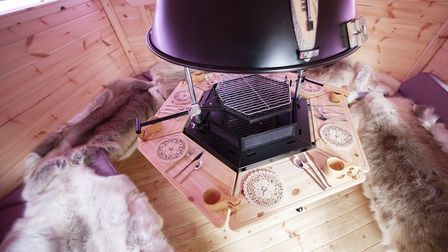The premium charcoal BBQ is a traditional Finnish design and sits at the very heart of the lodges wh
