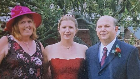Samantha with her mum and dad.