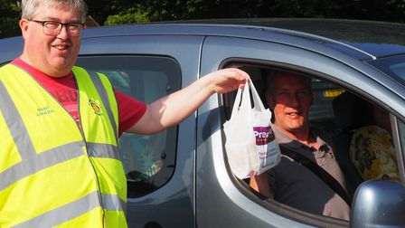 Mendip Rotarians hand out meals prepared by member Anwar Hussain. Picture: Rotary Club of Mendip
