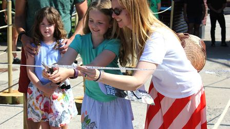 Polly Robertson, aged eight, reopened the zoo. Picture: Noahs Ark Zoo Farm
