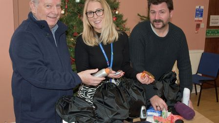Somewhere To Go Project Lead Barry Edwards, left, with bags of essential supplies for the homeless.