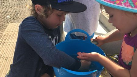 Tait and Hazel try out crabbing at Portishead Marina. Picture: The Nursery