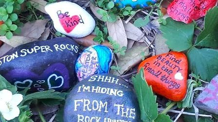Kindness rocks, decorated with pictures and positive messages.