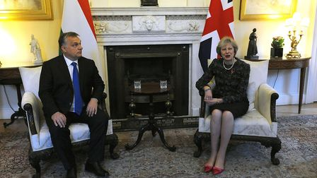 Prime Minister Theresa May sits with Hungarian PM Viktor Orban ahead of a bilateral meeting at Downi