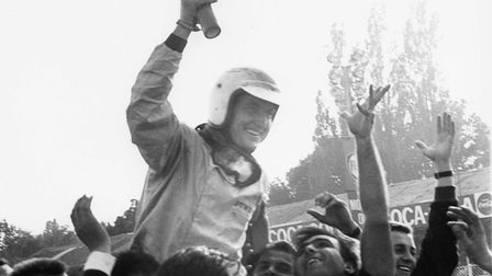 Italy's Ludovico Scarfiotti is mobbed following his Italian Grand Prix victory at Monza in 1966. Pic