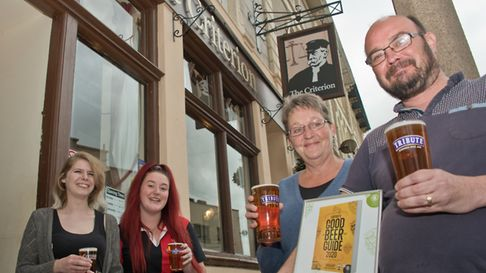 The Criterion landlord and lady Anthony and Karen Thomas with bar-staff Charlotte Murray and Alisha