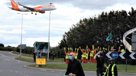 A plane flying over protesters outside Bristol Airport. Picture: Nick Page Hayman