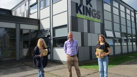 Chief executive Gavin Ball with students from Kings of Wessex Academy picking up their results.Pictu