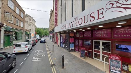 A man was knocked to the ground after being approached by three men outside the Playhouse last night