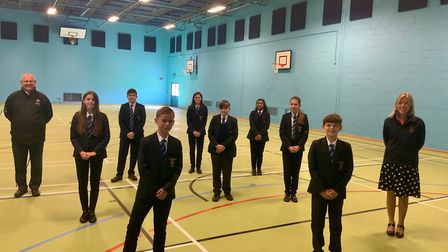 Students and teachers inside the upgraded sports hall. Picture: Shane Dean