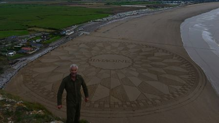 Landscape artist Simon Beck with one of his geometrical beach design