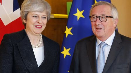 Theresa May, left, poses for the media with European Commission President Jean-Claude Juncker in Str