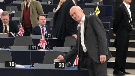 MEP Richard Corbett places a pint-sized Brexit protest on Nigel Farage's table. Photograph: Twitter.