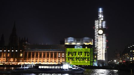 """A message projected on to the House of Commons urges MPs to """"put it to the people"""". Photograph: Vict"""