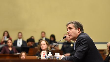 Michael Cohen, US President Donald Trump's former personal attorney, testifies before the House Over