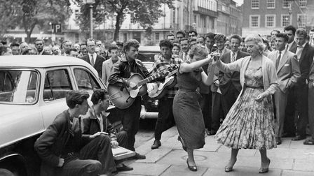 A skiffle band draws a crowd in London's Soho Square. the skiffle movement peaked in 1957. Photo by