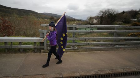 Aoife McGenity attends a a Border Communities Against Brexit protest on Old Belfast Road in Carrickc