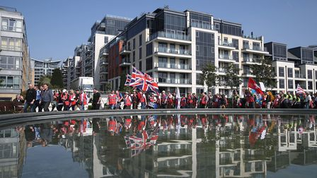 The March to Leave protesters make their way along Imperial Wharf in London. Picture: Steve Parsons/