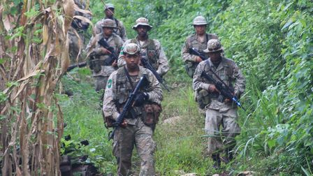 Sgt. Marcos Villagran and members of the Belize Special Assignment Group on patrol near the Guatemal