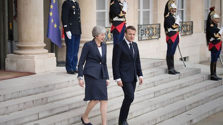 Prime Minister Theresa May with French President Emmanuel Macron leaves after Brexit talks at the �l