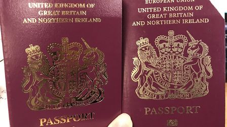 Handout photo taken from the twitter feed of SpinHBarone of her new passport (left) and her old pass