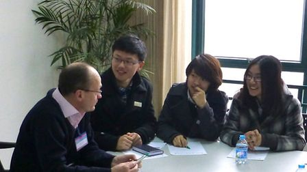 Julian Baldwin talking to students from China about their maths and science lessons.